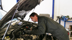 a mechanic fixing a diesel engine